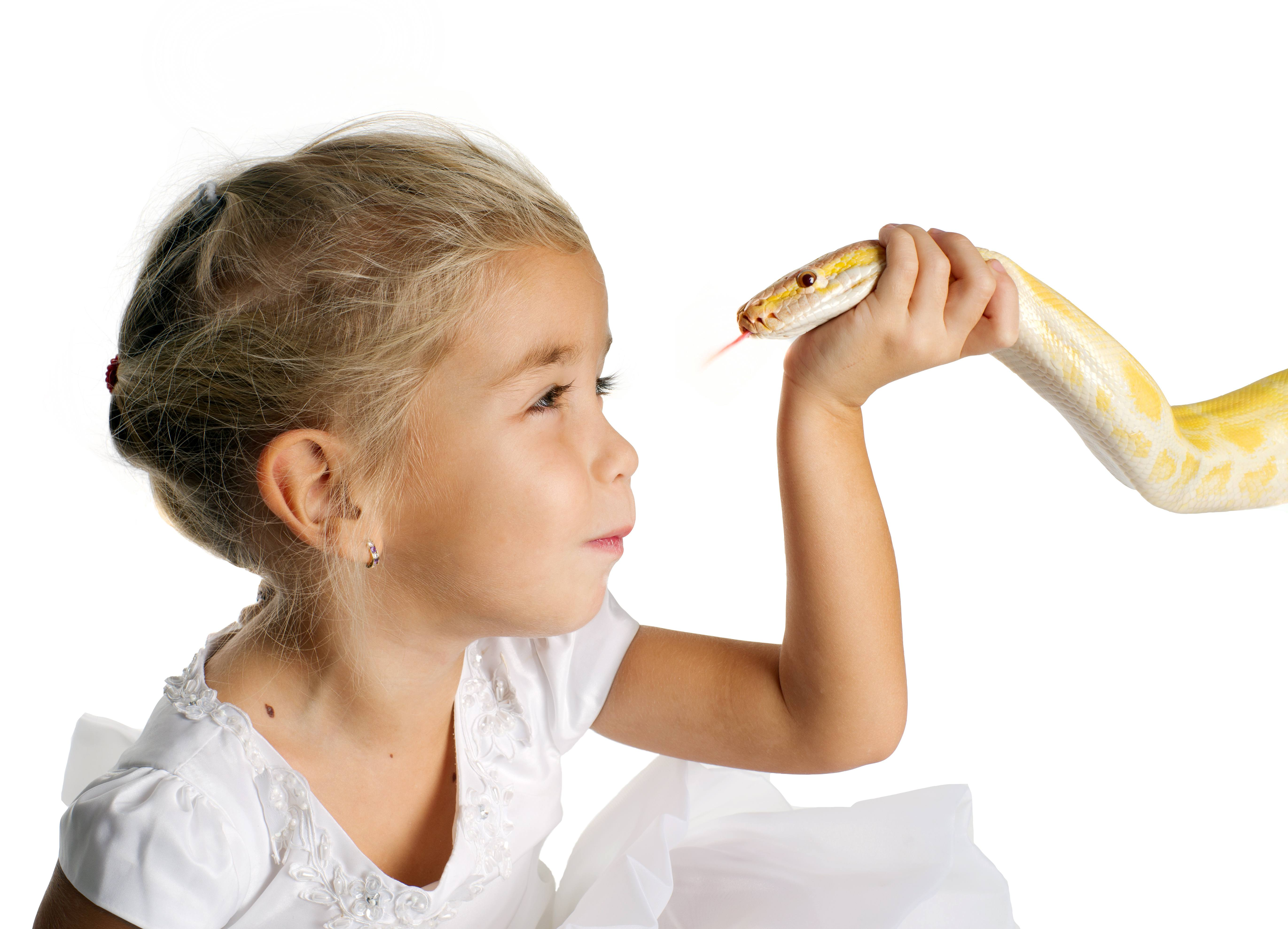 Little girl playing with pet snake