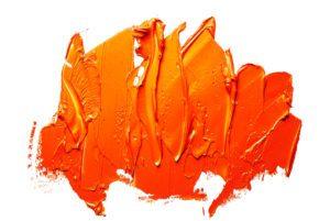 Orange oil paint spot on a white background.