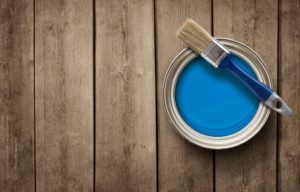 The paint can on the old wooden background with copy space.