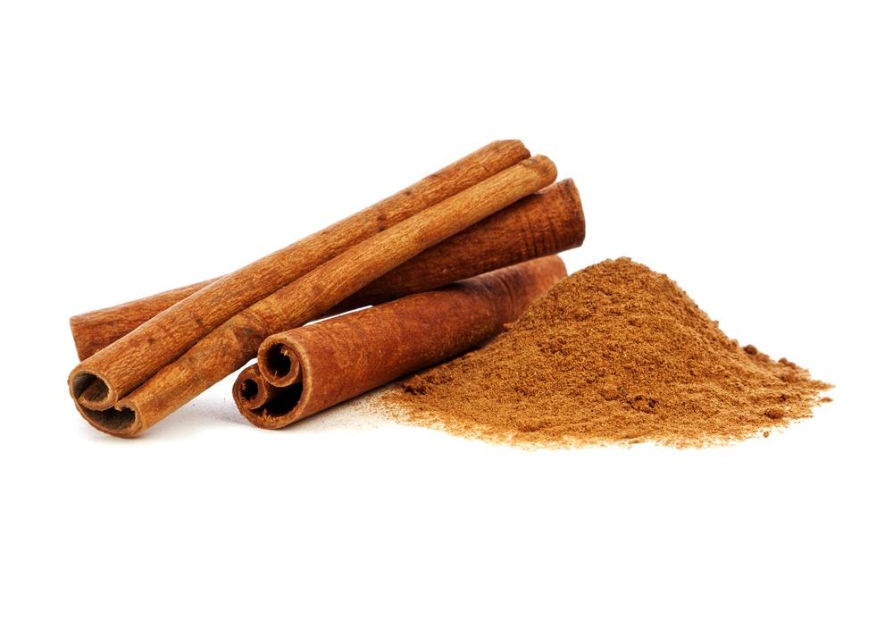Cinnamon sticks and powder on white background.