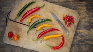 Types of hot peppers on wooden cutting plate