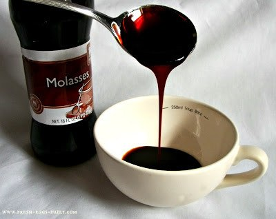 Pouring molasses in bowl