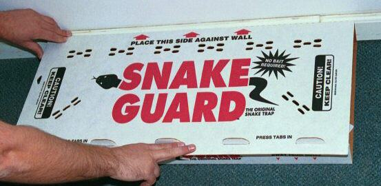 Man holding a snake guard box in his hand