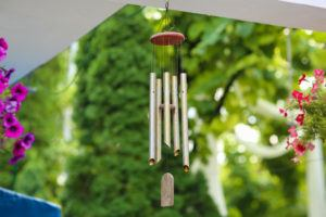 Hanging silver wind chimes to scare pigeons away