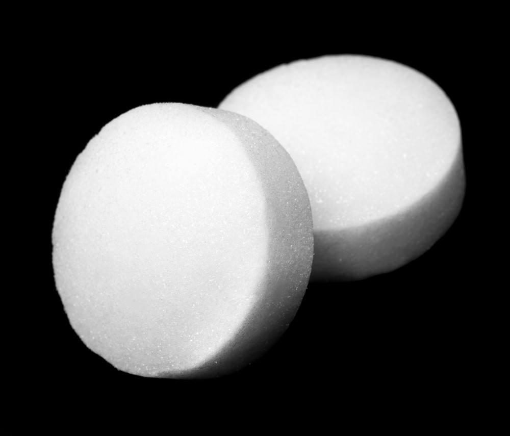 White naphthalene balls over dark background.
